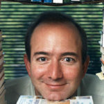 Jeff-Bezos-in-a-pile-of-books-590317